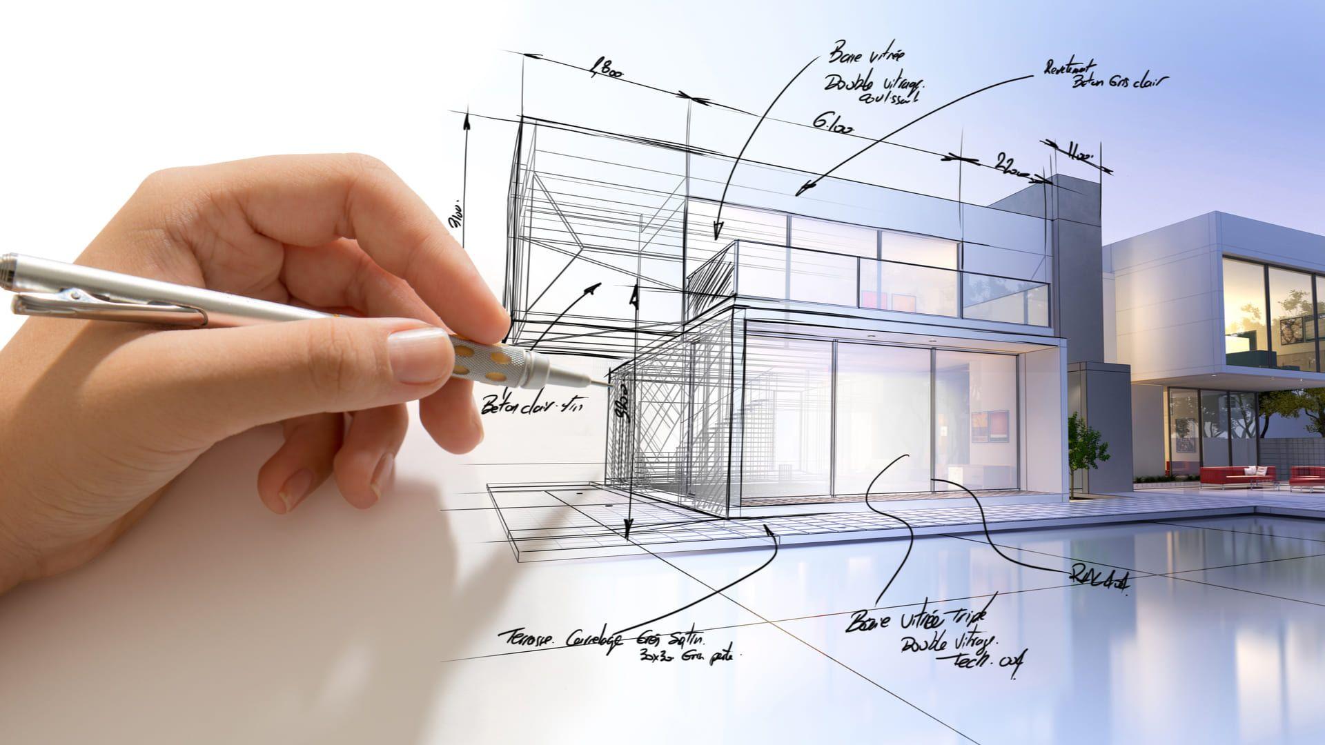 Mão segurando caneta em cima de desenho de casas