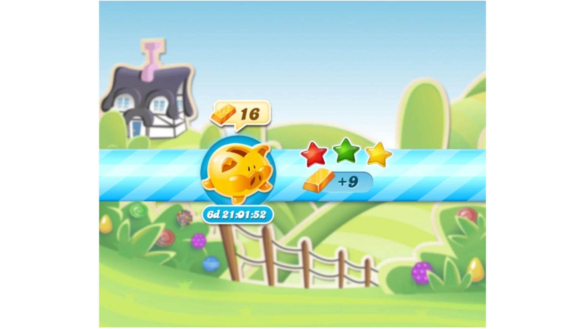 Print do jogo Candy Crush com porquinho amarelo e três estrelinhas
