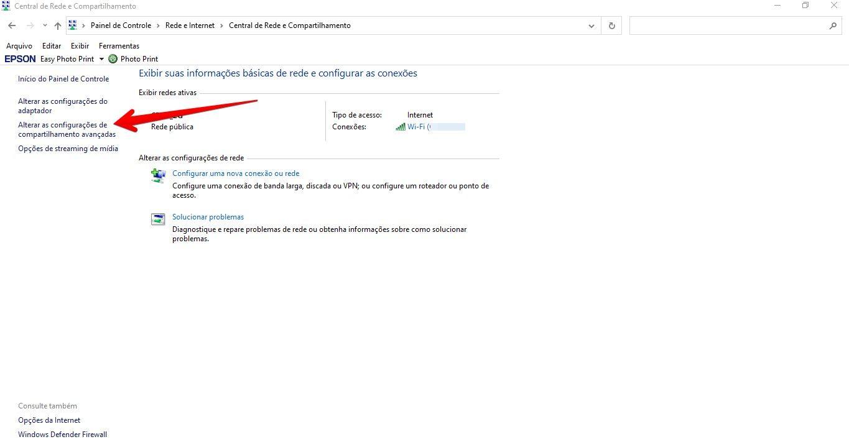 """Tela do Windows com seta apontando para opção """"Alterar as configurações de compartilhamento"""""""