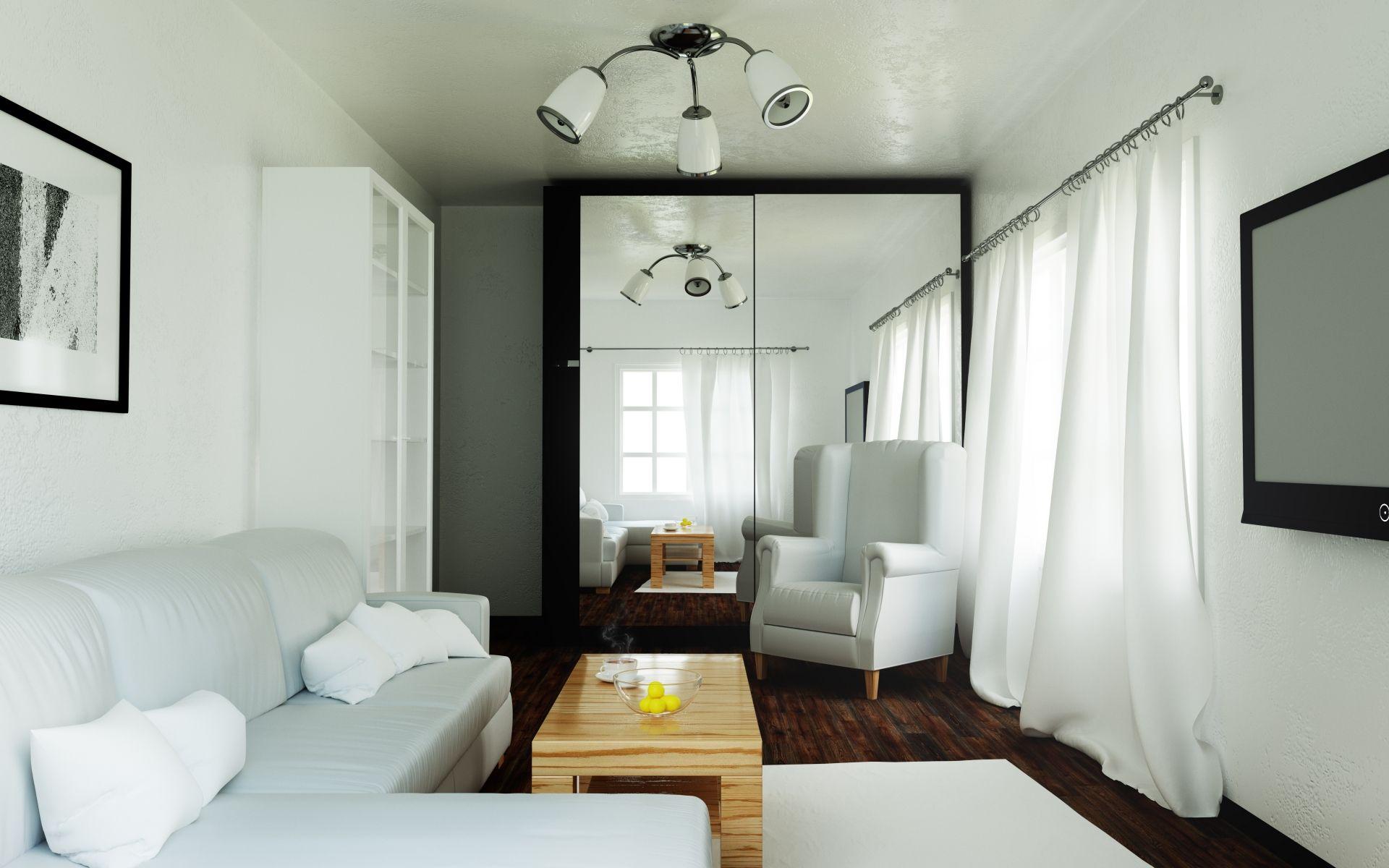 Sala de estar com paredes e cortinas brancas, sofá cinza e um armário com portas de correr espelhadas no fundo
