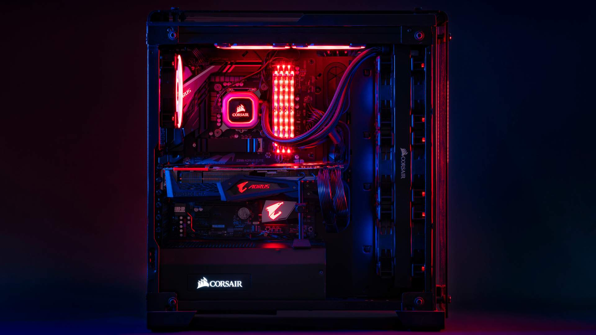 parte interna de um computador gamer da marca corsair com luzes rgb em tom vermelho