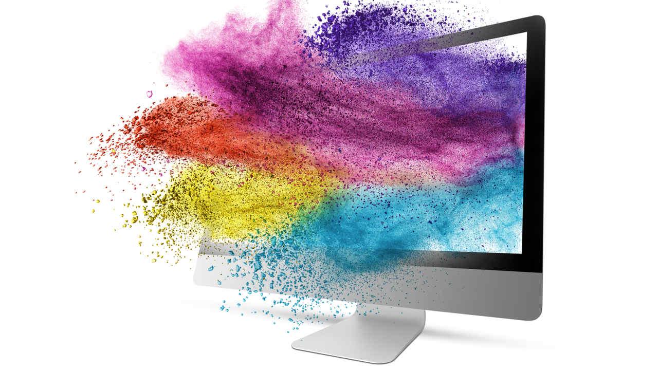Monitor com fundo de tela com várias cores emergindo
