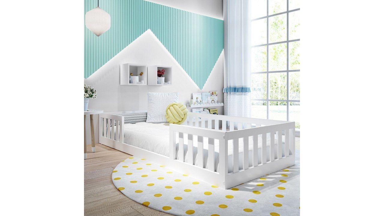 Cama Montessoriana Solteiro Maria sobre tapete de bolinhas amarelas, em quarto decorado.