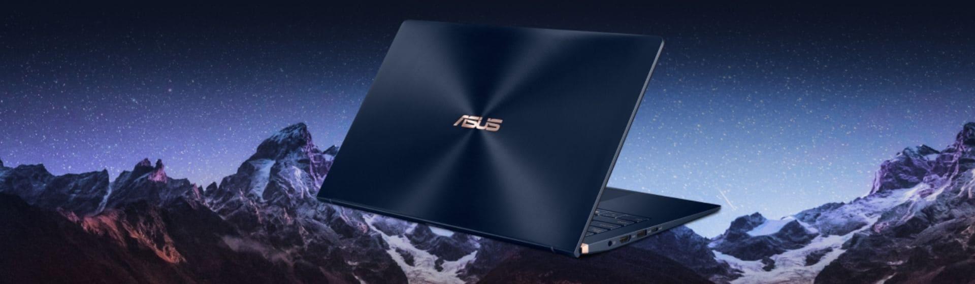 Notebook Asus Zenbook azul escuro com montanhas ao fundo