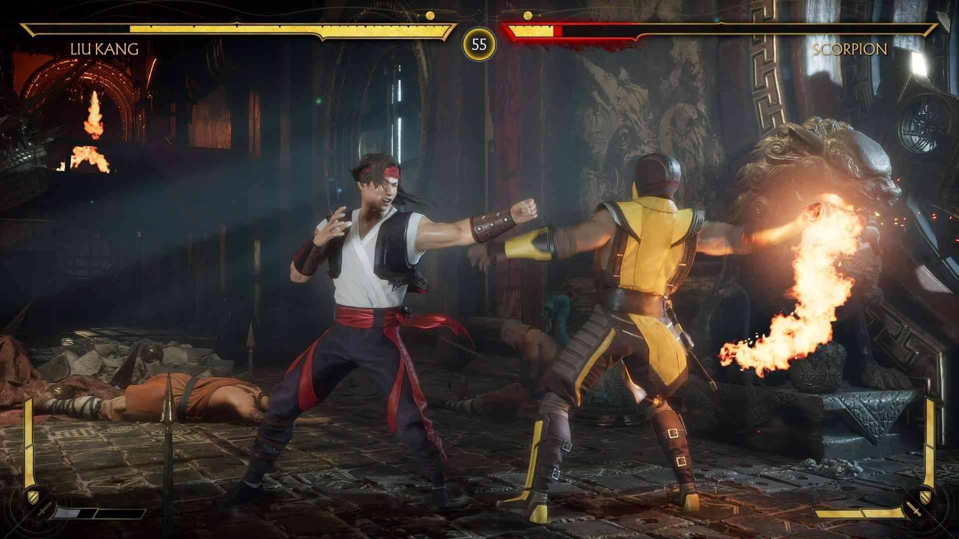 Captura de tela do jogo Mortal Kombat 11 mostrando uma luta entre Liu Kang e Scorpion