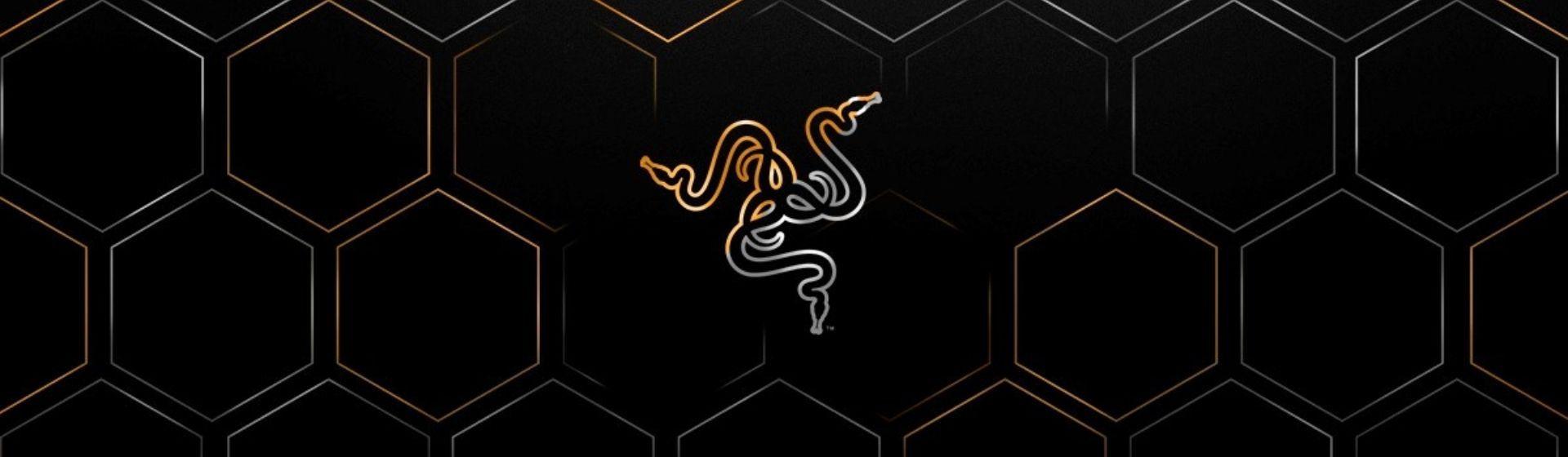 Logo da Razer dourado no fundo preto com hexágonos