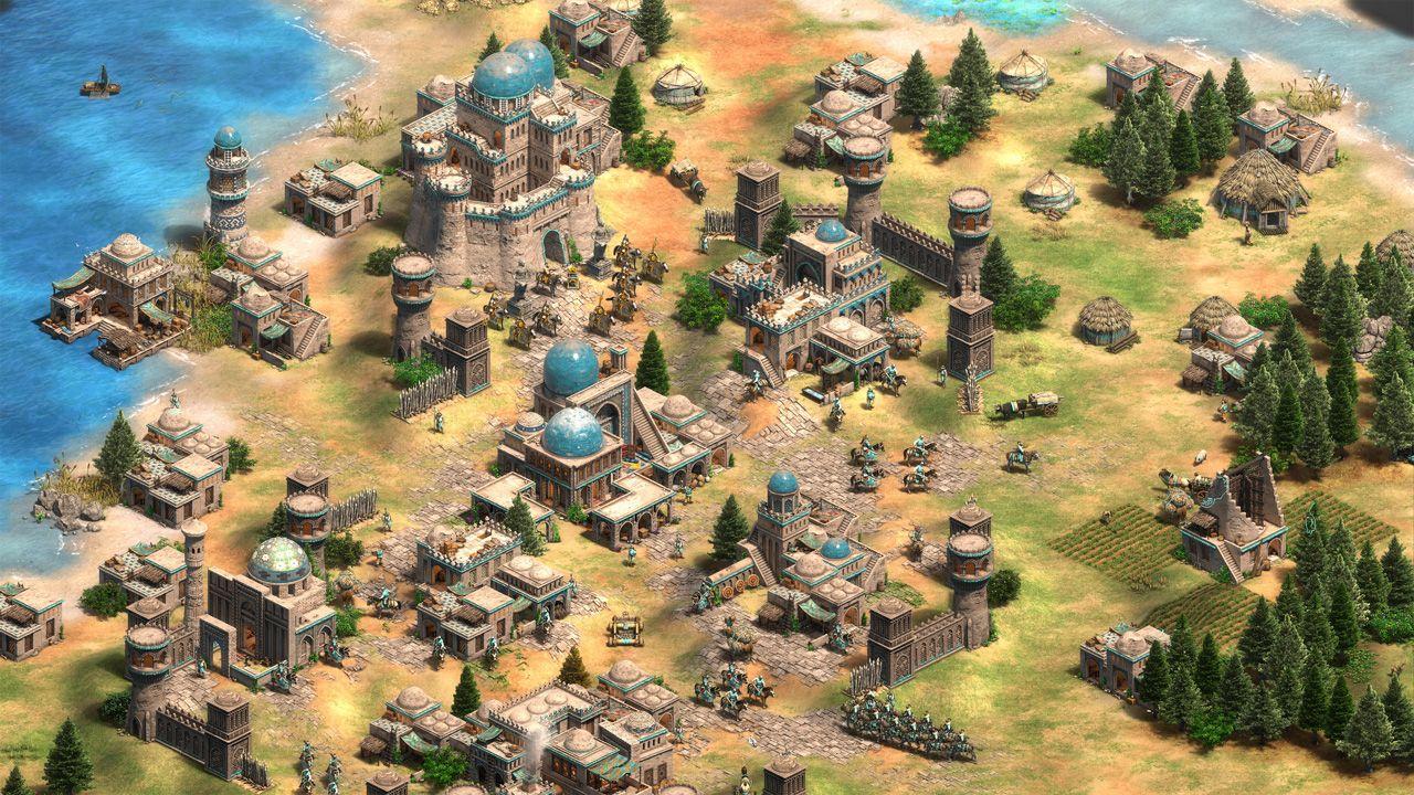 Tela do jogo Age of Empires 2, com uma base que tem diferentes edifícios