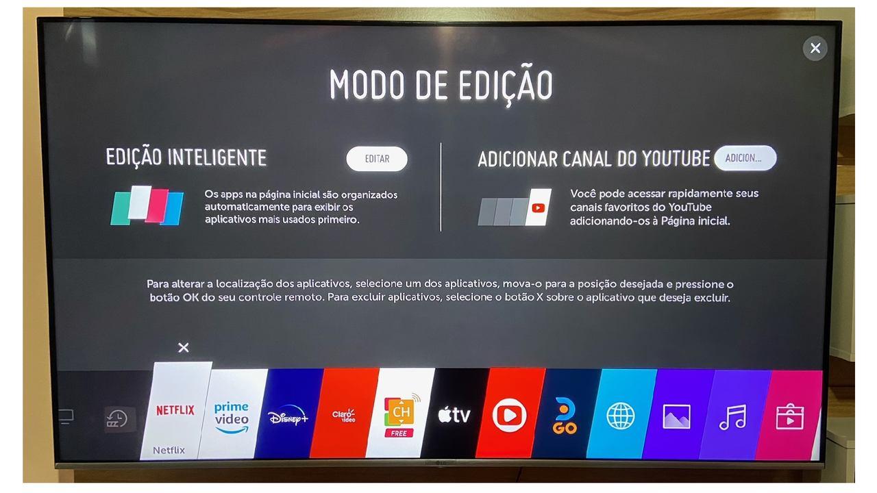 Tela da Smart TV com o modo de edição aberto e aplicativo da Netflix selecionado para excluir