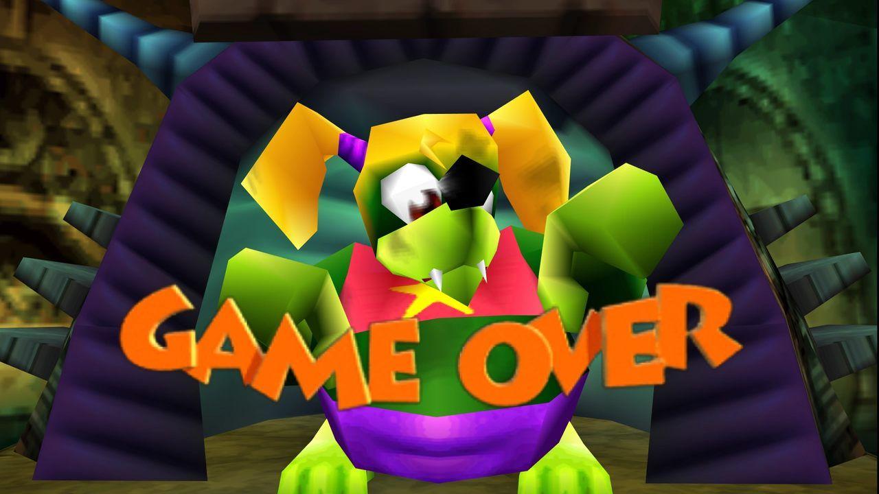 Game Over de Banjo Kazooie com imagem da personagem Tooty em versão monstruosa com pele verde e cabelo loiro e a expressão Game Over embaixo