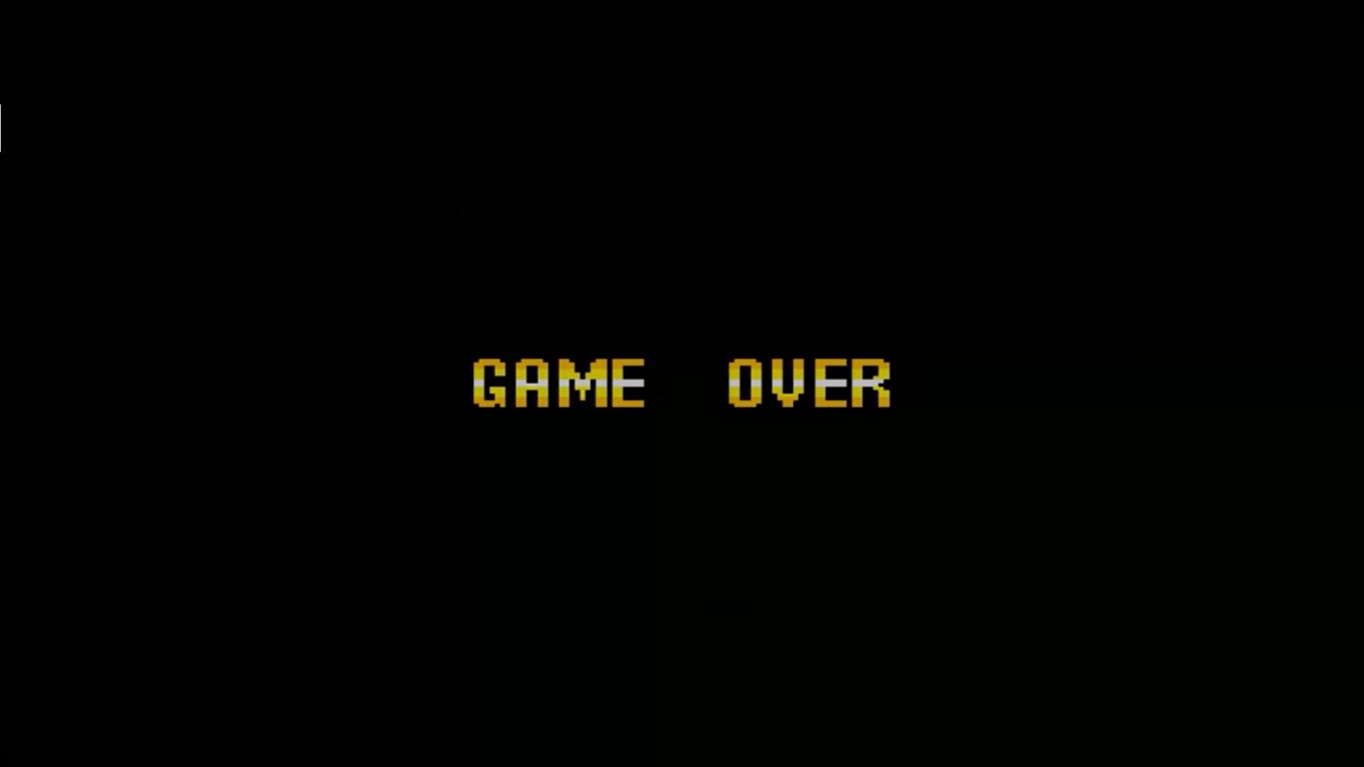 Game Over de Super Mario World com tela preta com a expressão Game Over em amarelo no meio